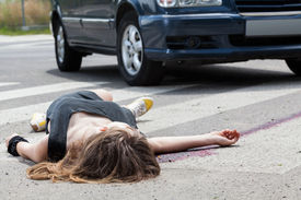 picture of street-walker  - Dead woman lying on a street after road accident - JPG