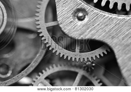 Black And White Background With Metal Cogwheels Inside Clockwork. Macro