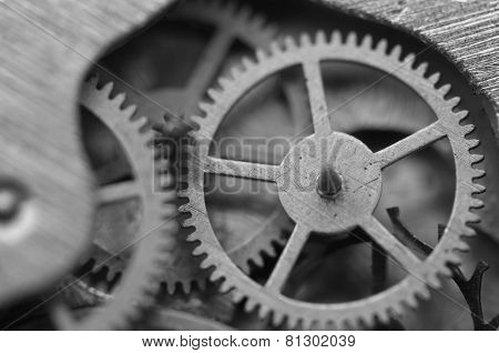 Black And White Background With Metal Cogwheels Inside Clockwork. Macro.