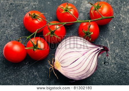 Bunch of red tomatoes and red onion