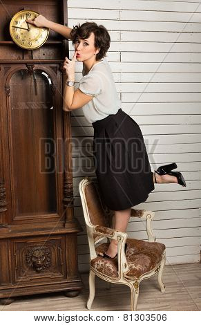 Beautiful Woman Rewinding The Clock