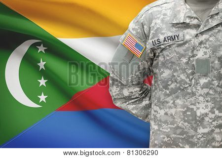 American Soldier With Flag On Background - Comoros