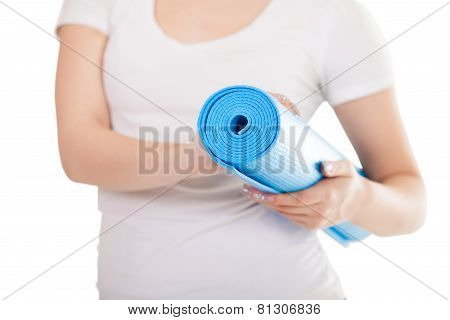 Folded Blue Yoga Mat In Woman Hands