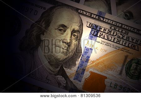 One hundred dollars as background