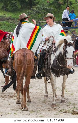 Young Latin Women Dressed In National Costumes Riding Horses