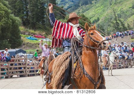 Banos, Ecuador - 30 November 2014: Indigenous Cowboy Riding Horse And Swinging Lasso, South America In Banos On November 30, 2014