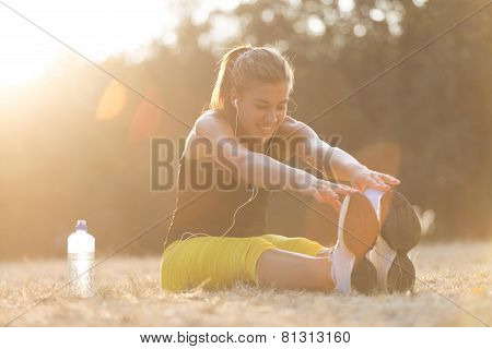 Young girl stretching in the park