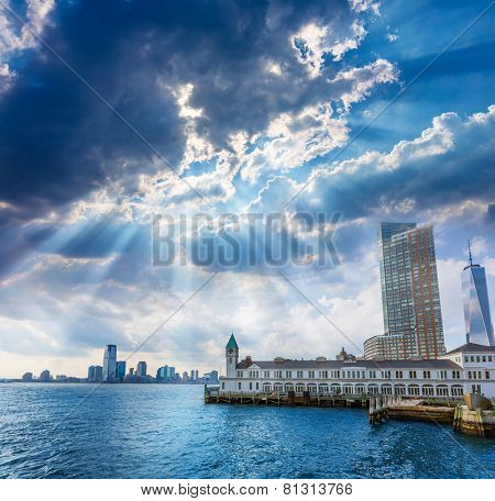 Pier A in Battery Park Manhattan skyline New York and Jersey with dramatic ky
