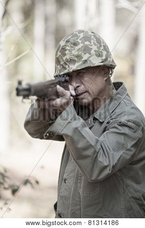 man in period accurate world war two uniform firing weapon