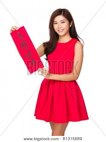 Woman hold with Fai Chun for chinese new year, phrase meaning is blessing for good health