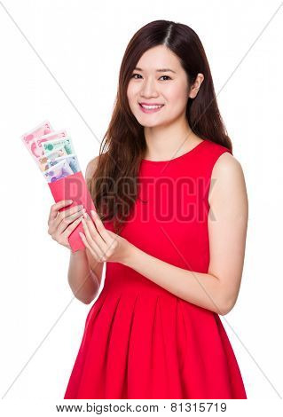 Woman hold lucky money with RMB