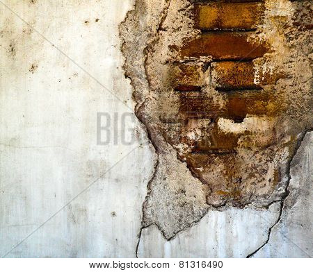 Hole in wall, revealing brick