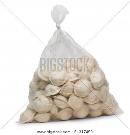 raw dumplings in plastic cellophane bag isolated on white backgr