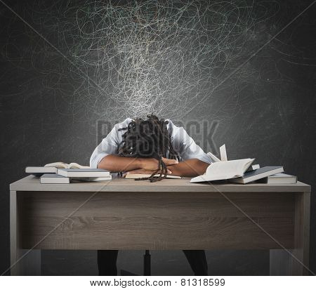 Man dreaming over books