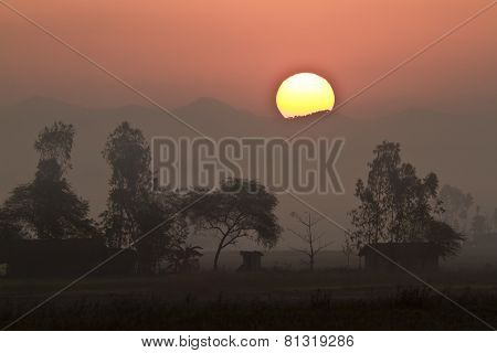 wonderful sunset on a tharu village, Bardia, Nepal