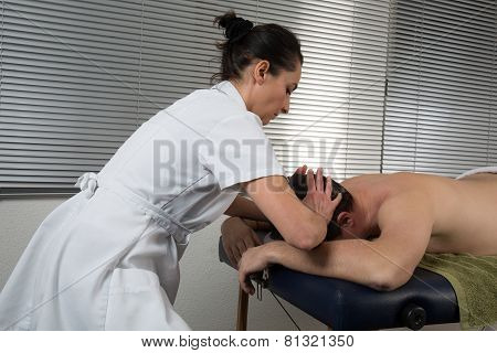 A Woman Spirit Healer Doing Reiki Treatment To A Man