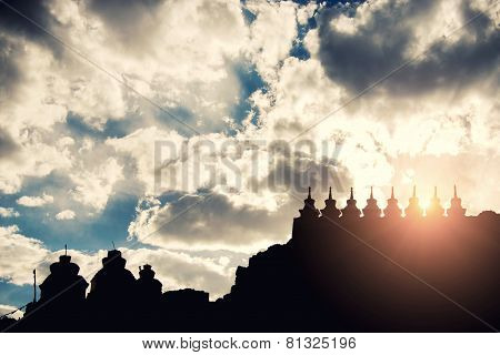 silhouette stupa at Shey Palace. Dramatic sky. Filtered image:cross processed vintage effect. Ladakh