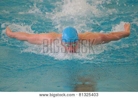 GRAZ, AUSTRIA - APRIL 05, 2014: Robert Zbogar (Slovenia) wins the men's 200m butterfly event in an indoor swimming meeting.