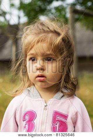 Closeup portrait of a little cute girl outdoors