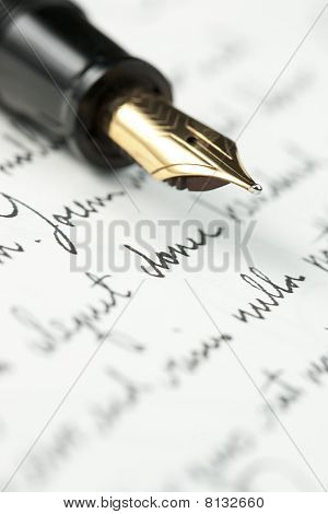 Gold Fountain Pen On Hand Written Letter