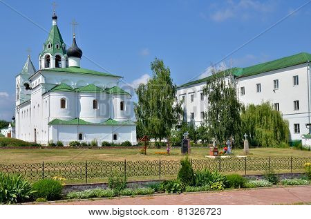 Cathedral With Bell Tower And Cemetery In  Russia