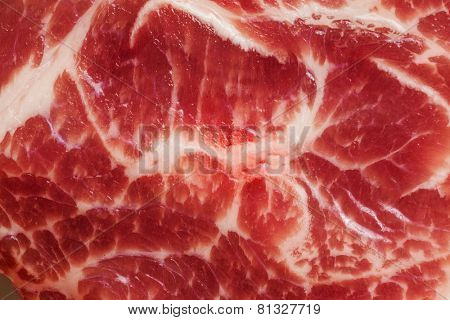 Background texture of uncooked marbled fatty meat for use as a cooking ingredient for dinner