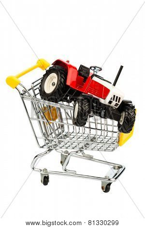 a tractor into cart as a symbol for the purchase of a new agricultural equipment