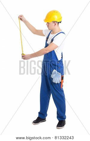 Side View Of Man Builder In Blue Coveralls Holding Measure Tape Isolated On White