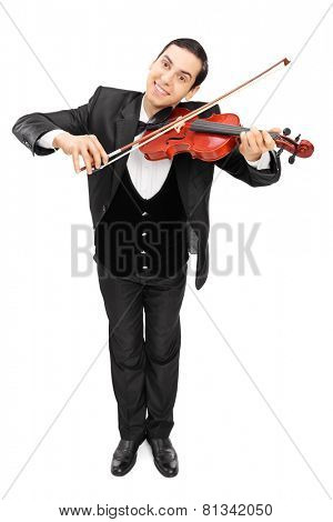 Full length portrait of a cheerful violinist playing a violin isolated on white background
