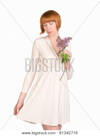 Romantic young woman in pastel dress with a lilac and modest look