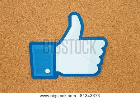 Facebook thumbs up sign  placed on cork bulletin board
