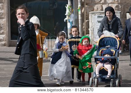 Jerusalem, Israel - March 15, 2006: Purim Carnival. Ultra Orthodox Woman WithChildren
