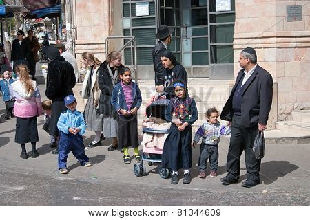 Jerusalem, Israel - March 15, 2006: Purim Carnival. Children And Adults Dressed In Traditional Jewis
