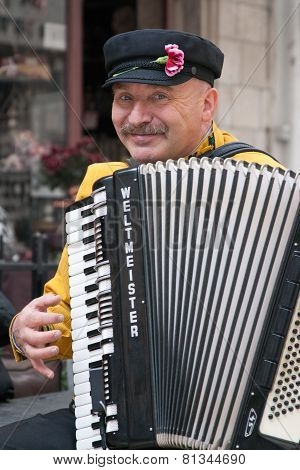 Jerusalem, Israel - March 15, 2006: Purim Carnival, Street Musician Plays The Accordion.