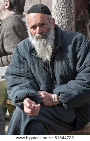 Jerusalem, Israel - March 15, 2006: Purim Carnival. Portrait Of A Tramp Begging.