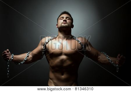 Concept of liberation. Naked man breaks chain