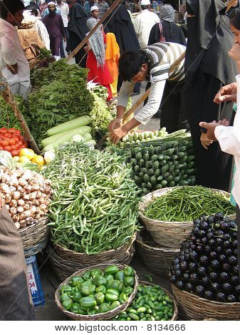 Young Indian Man Sells Vegetables In The Market