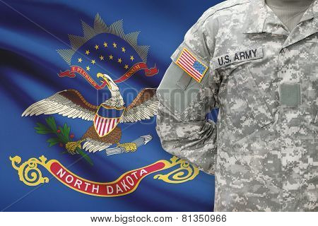 American Soldier With Us State Flag On Background - North Dakota