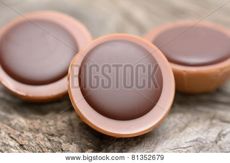 A Hazelnut In Caramel With Creamy Nougat And Chocolate On Wooden Background