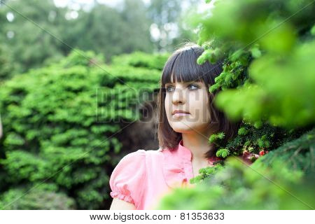closeup portrait of beautiful young woman in the forest