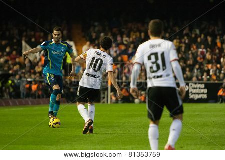 VALENCIA, SPAIN - JANUARY 25: Iborra with a ball and Parejo during Spanish League match between Valencia CF and Sevilla FC at Mestalla Stadium on January 25, 2015 in Valencia, Spain