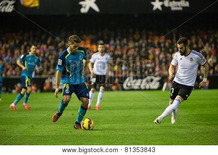 VALENCIA, SPAIN - JANUARY 25: Carrico (L) and Negredo during Spanish League match between Valencia CF and Sevilla FC at Mestalla Stadium on January 25, 2015 in Valencia, Spain