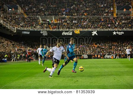 VALENCIA, SPAIN - JANUARY 25: Gomes (L) and Krychowiak during Spanish League match between Valencia CF and Sevilla FC at Mestalla Stadium on January 25, 2015 in Valencia, Spain