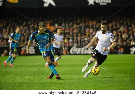 VALENCIA, SPAIN - JANUARY 25: Carrico (L) and Negredo during Spanish League match between Valencia CF and Sevilla FC at Mestalla Stadium on January 25, 2015 in Valencia, Spain