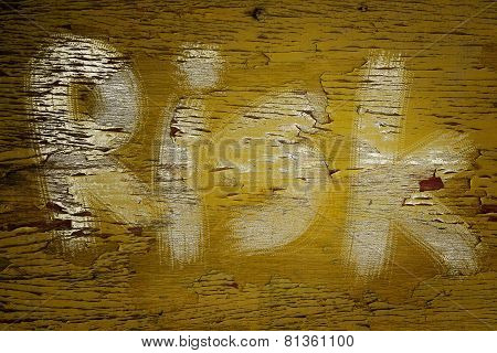 Risk Text On Yellow Old Wood Background