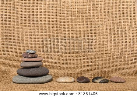 Stone Cairn, Stones, And Burlap Background