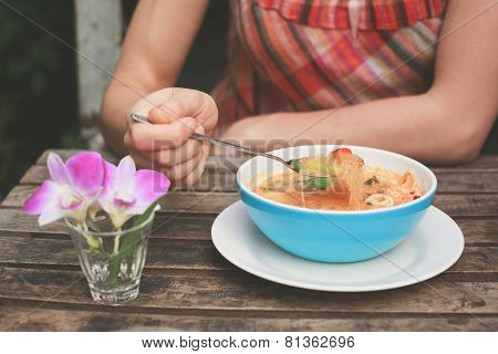 Woman Eating Tom Yum Soup