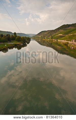 Vineyards At The Hills Of The Romantic River Mosel Edge In Summer With Fresh Grapes And Reflection I