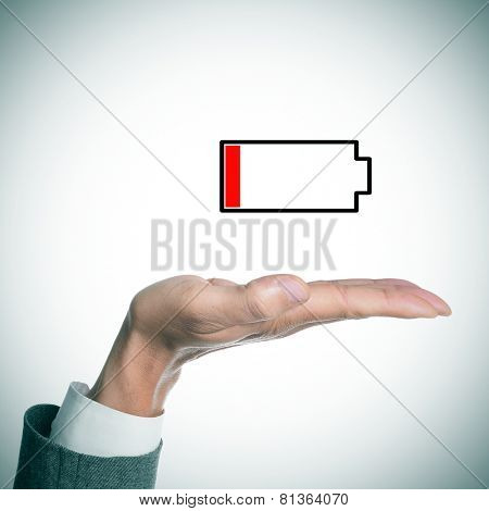 the hand of a businessman holding an illustration of a low battery