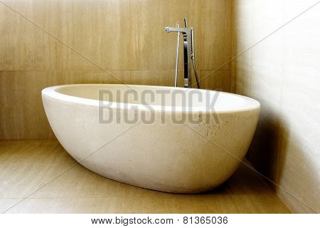 Beautiful Modern Bathtub and Tap in the Corner of Tiled Bathroom